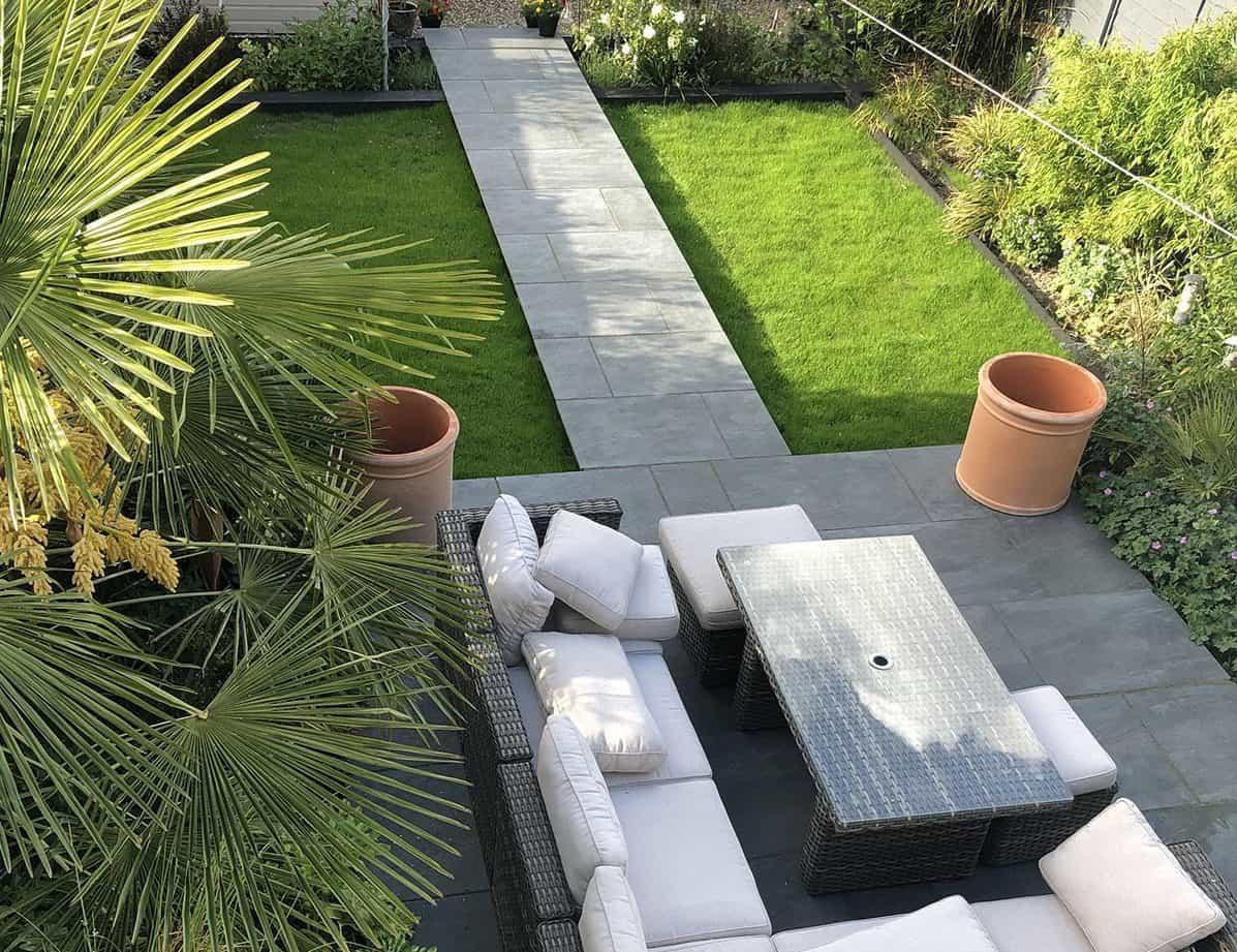 Rattan garden furniture set on a nero porcelain pavement/foundation