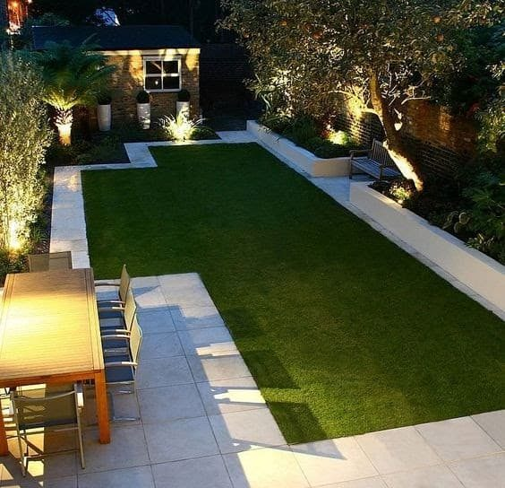 Border paving, highlighting the lush, green lawns at the centre