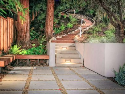 Garden stairway with graceful curves and pavers