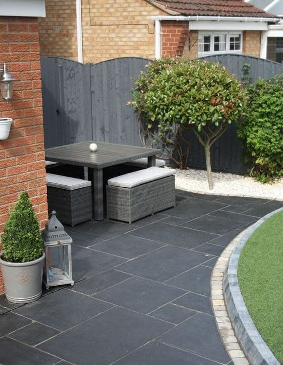 Contemporary style backyard with garden furniture and Indian sandstone in grey