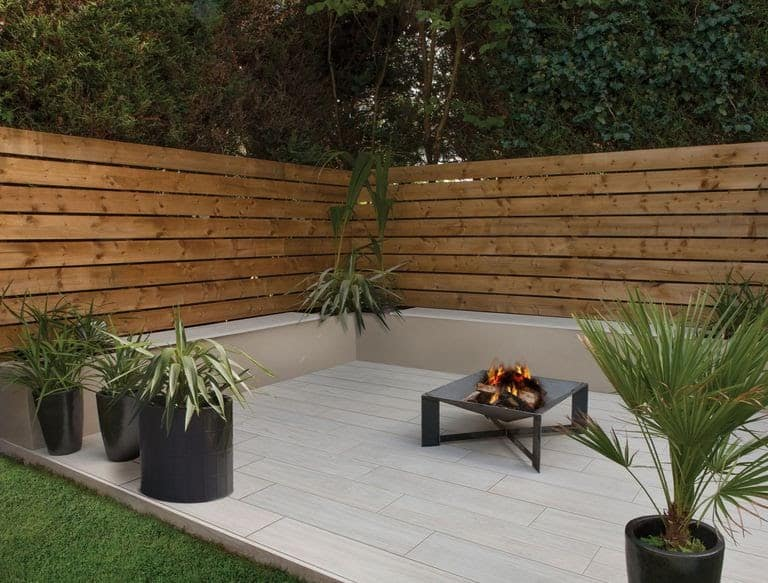 A combination of wood interior and porcelain garden pavement