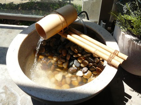 A piece of bamboo used as a mini fountain