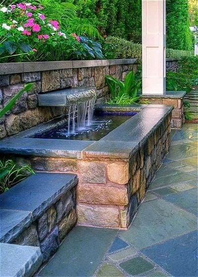 A raised pond with stone ledge