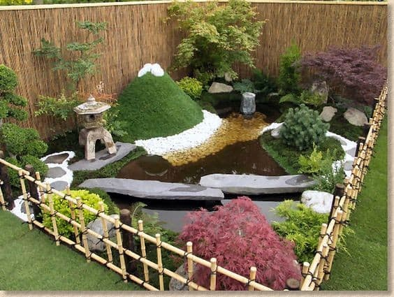 A mini garden with bamboo fence