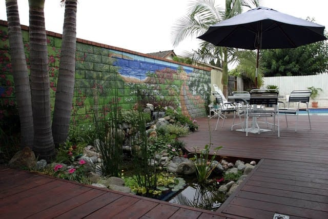 A cute water garden carved into the decking