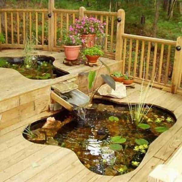 A miniature pond hidden away in the decking