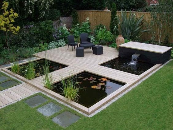 An ultramodern island-style seating area above the pond