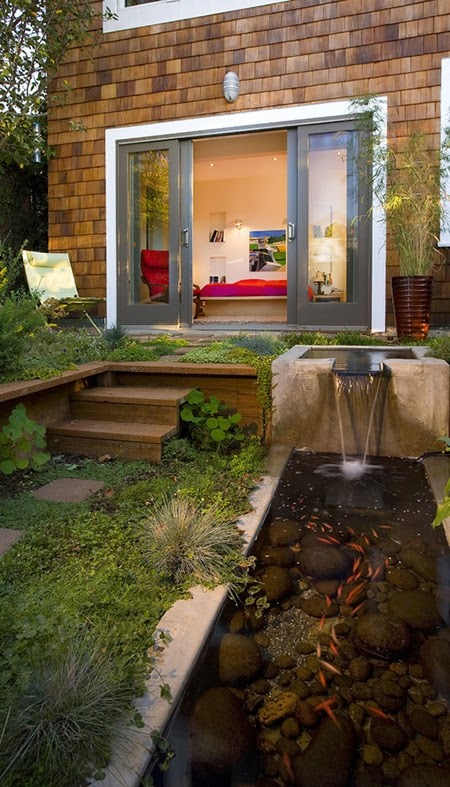 An innovative oblong pond with stunning water features