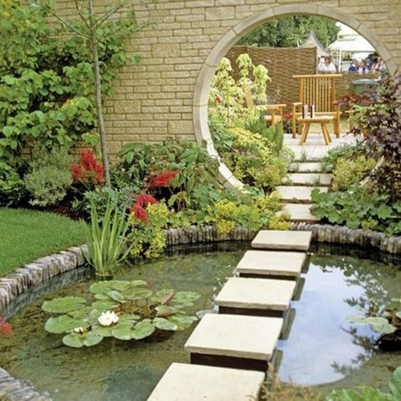 A mirror as a reflective source, adding extra space and light to the pond and overall garden