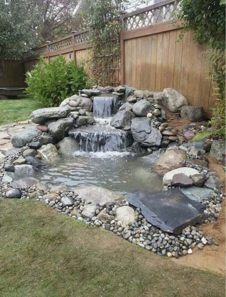 A waterfall and pond made from stones