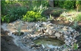 Recycled tractor tire pond with a stream