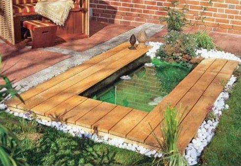A pond with wooden elements