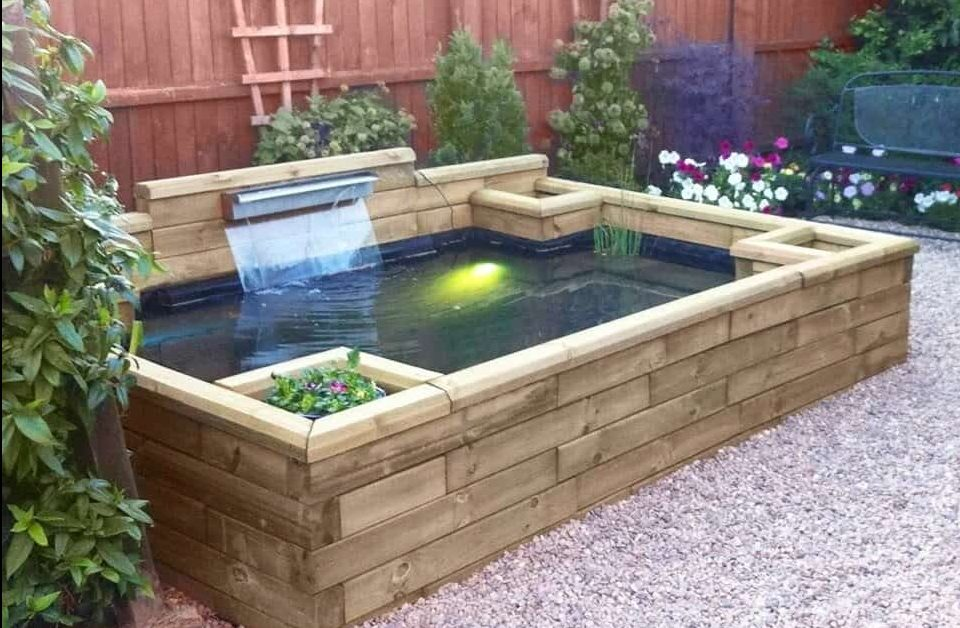 A raised garden pond made from wooden sleepers
