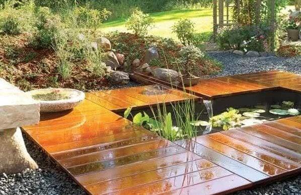 Garden pond and wooden deck
