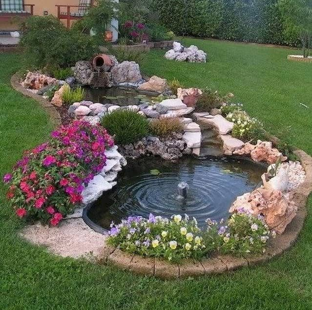Small, double garden pond with waterfall and fountain