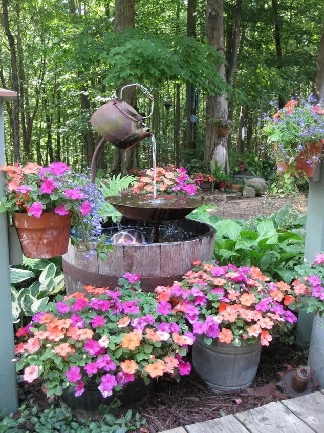 Recycled old teapot used as water feature decoration/fountain