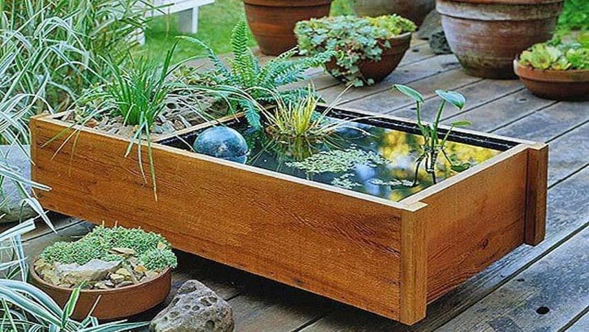 Mini water garden pond made from wooden blocks