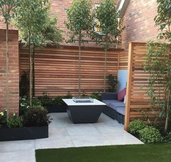 A simple tall, wooden fence for added privacy outdoors