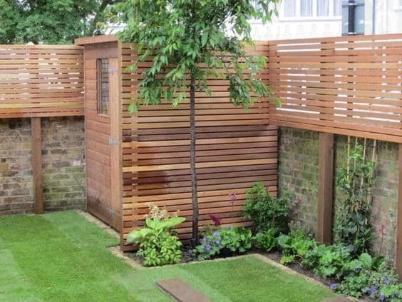 Wood panels extending a low wall for extra privacy