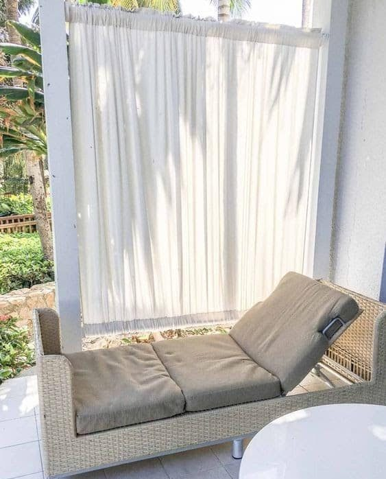 White curtains that adds some privacy to a small space