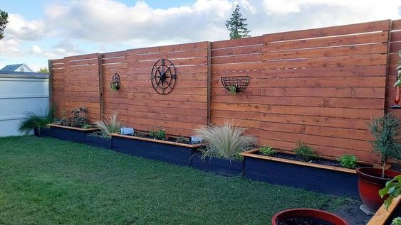 Raised garden beds along your fencing