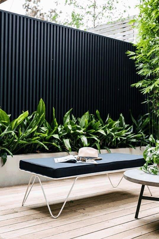 Modern look backyard with black vertical fencing