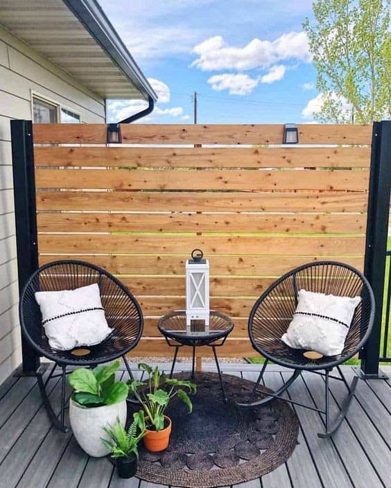 Small fence providing privacy to an outdoor seating area
