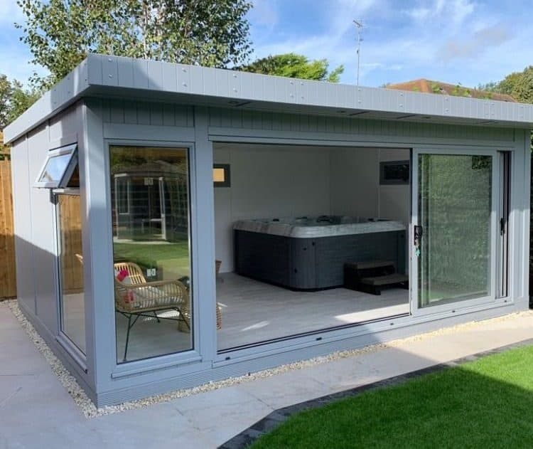 A garden room with a hot tub installed inside