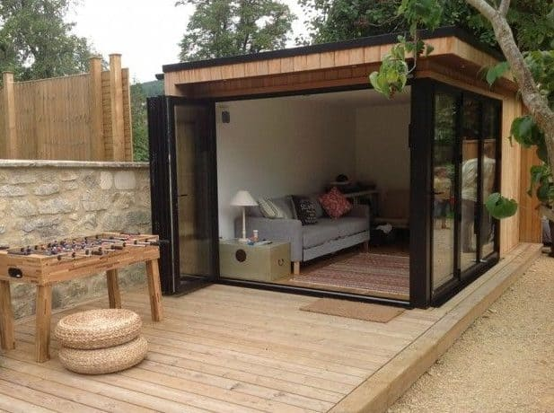 A wooden garden room with wooden deck