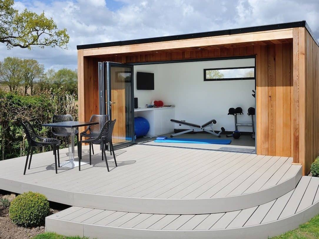 A personal garden gym with outdoor seating and concrete decking