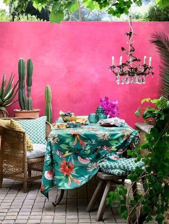 A cosy yet elegant patio set-up with colourful and bright background and accessories