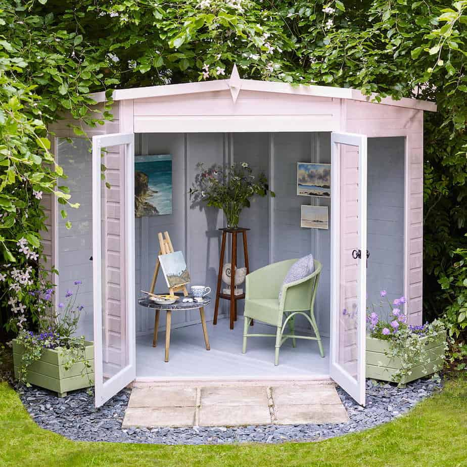Mini shed studio painted in pink and lilac colours