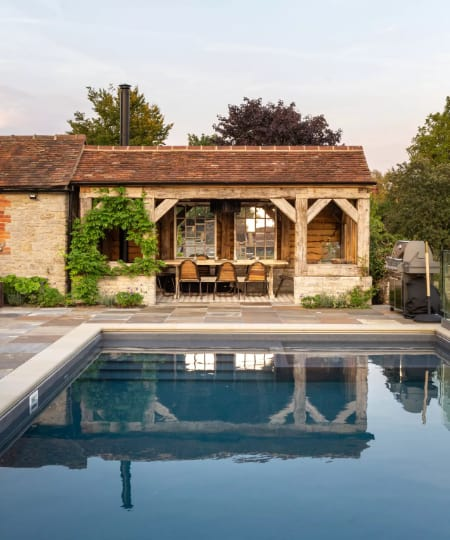 A rustic classy pavilion with al fresco dining and entertainment space by the pool