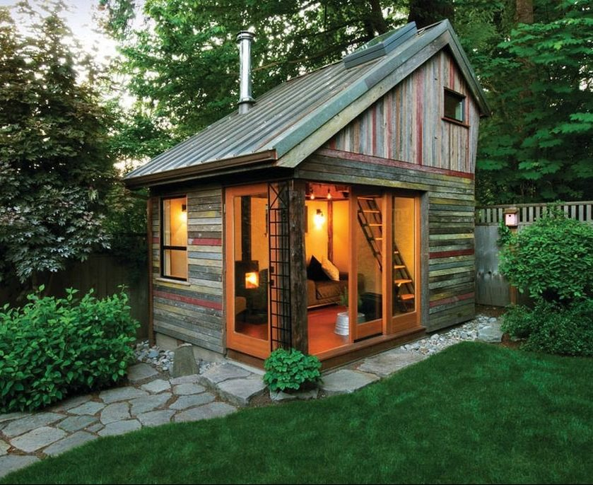 A corner garden building used as a guest bedroom