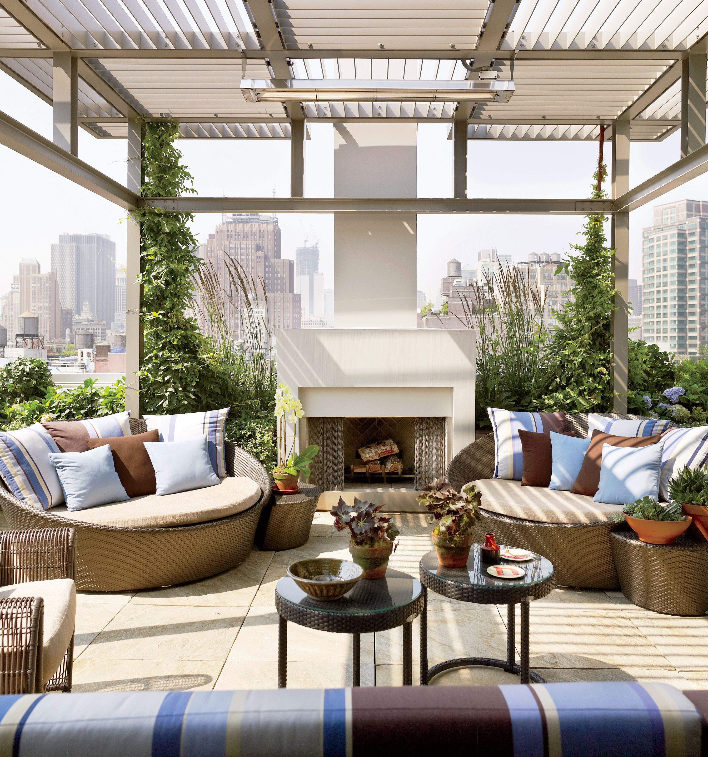 Refined rooftop hangout area with trellis and fireplaces