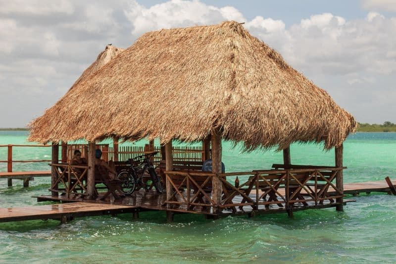 Palapa straw-roof hut on a jetty on the water