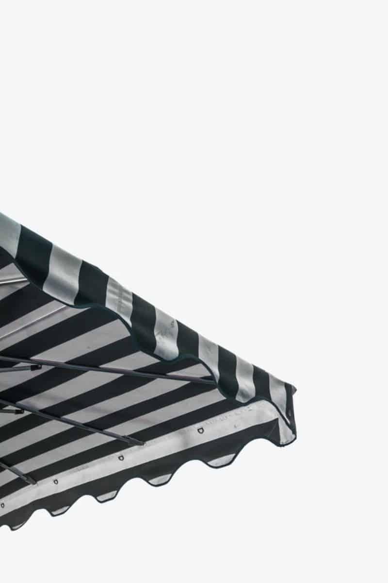 black and white striped edge of a gazebo against a grey sky