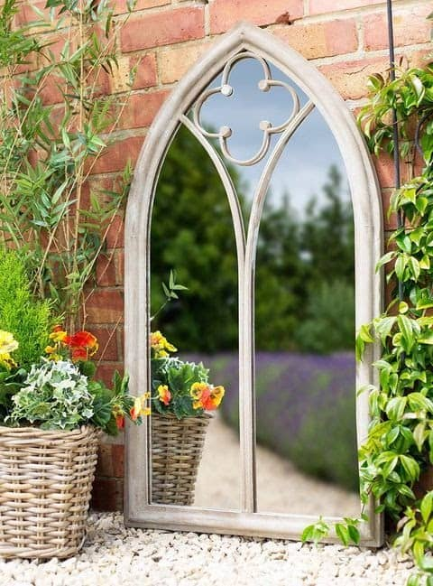 A wide mirror, making a garden looked bigger