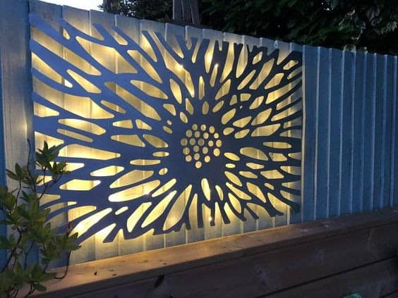 An old fence with majestic laser cut metal art