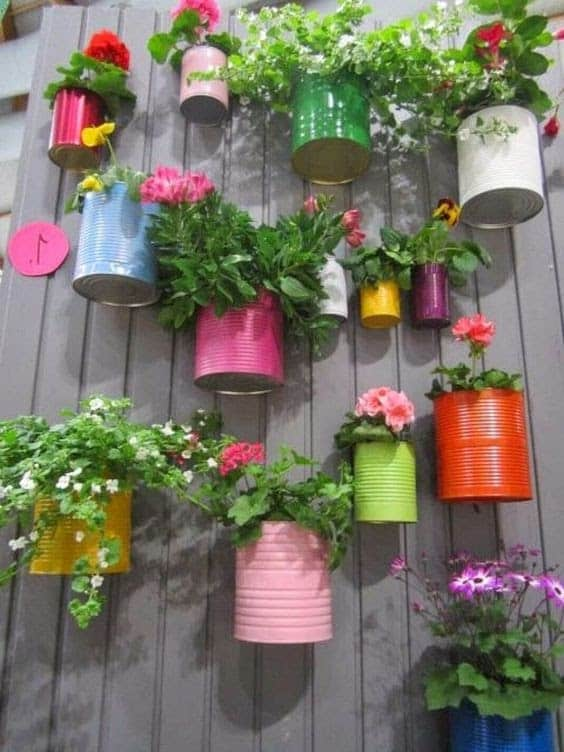 DIY colourful old cans as plant pots