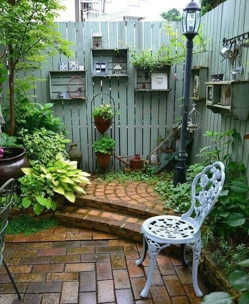 Backyard fence with sections and some shelvings