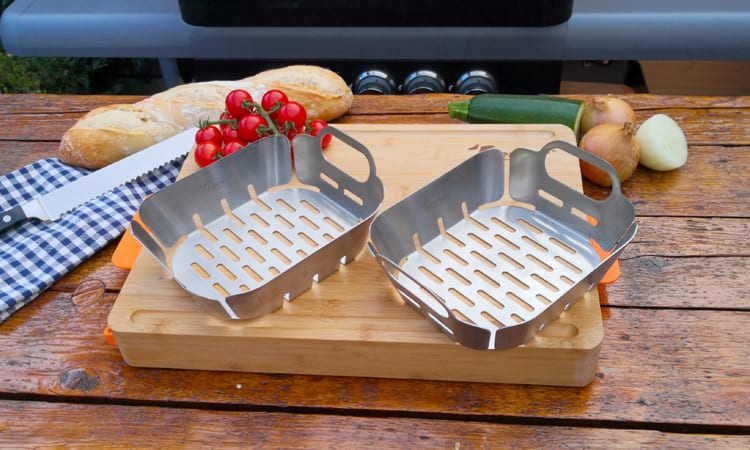grill baskets on chopping board surrounded by bread and oven