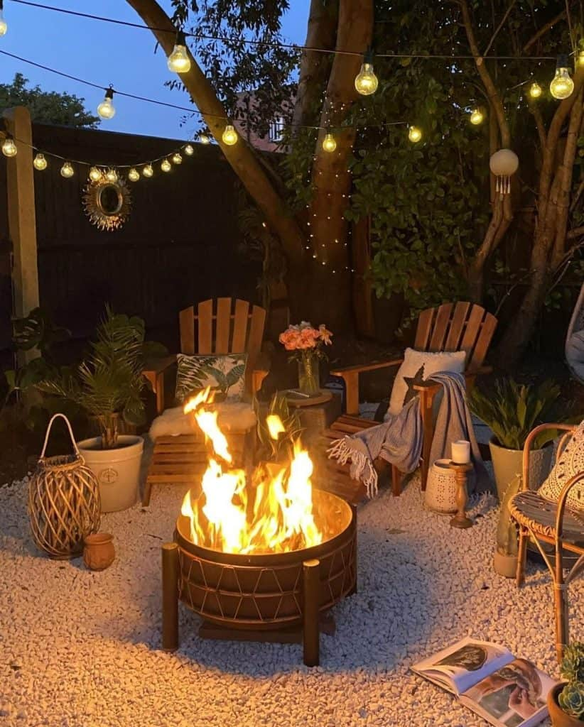 fire pit with lights on gravel