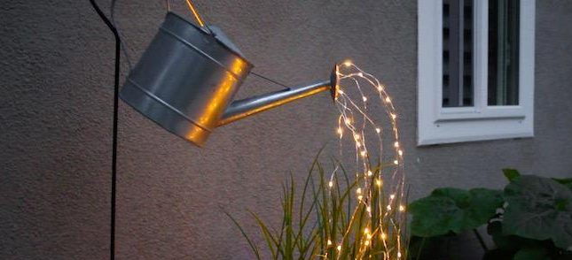 """glowing watering can """"pouring"""" lights"""