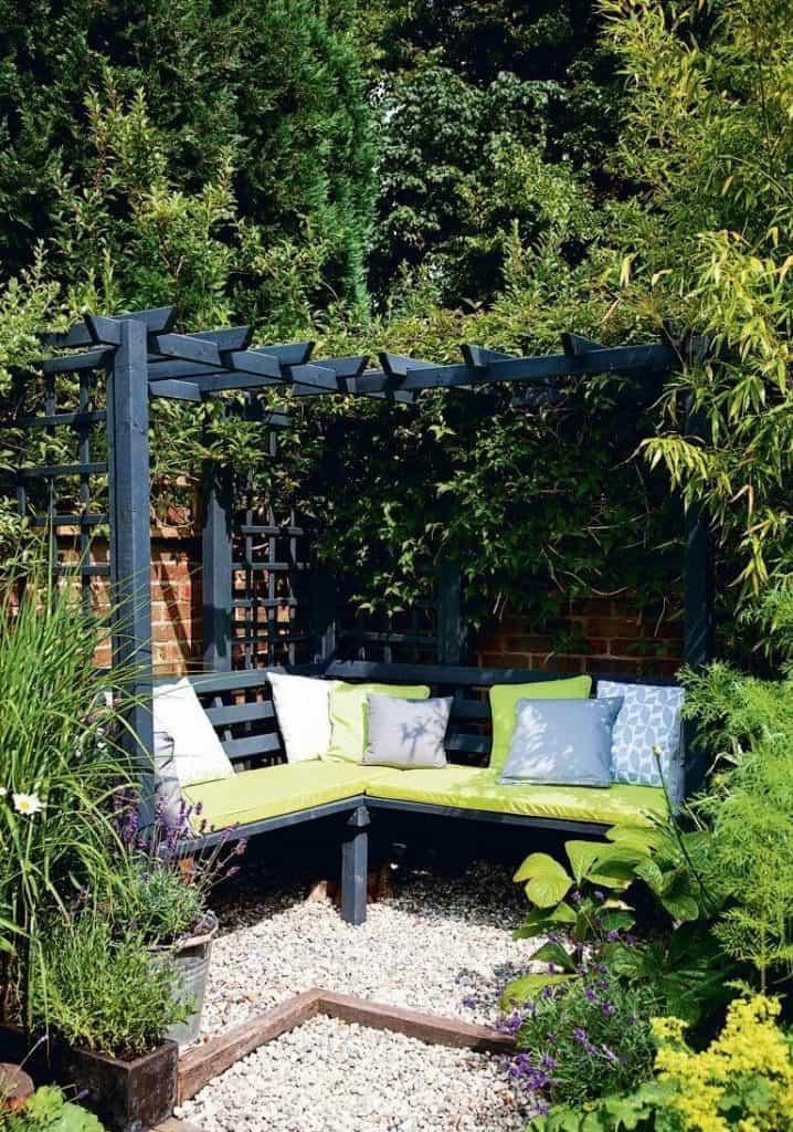 corner pergola with climbing plants and cushions