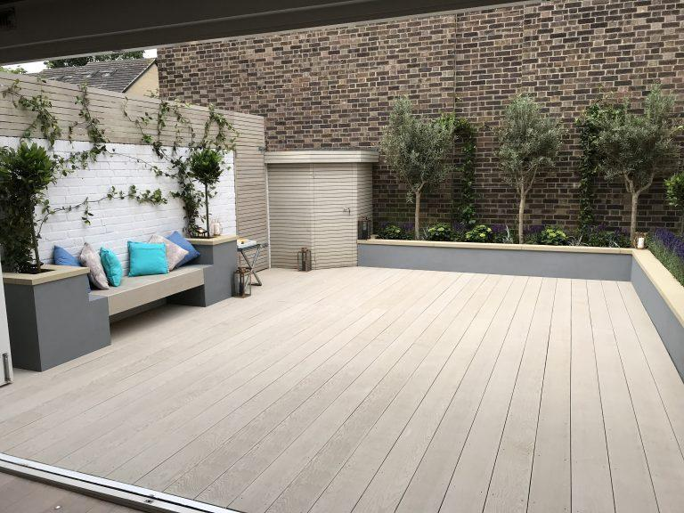 contemporary modern garden with large decking area
