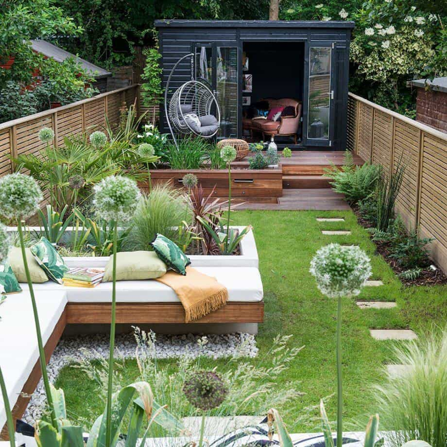 Multi-zone garden with shed and hanging chair at the end of the garden