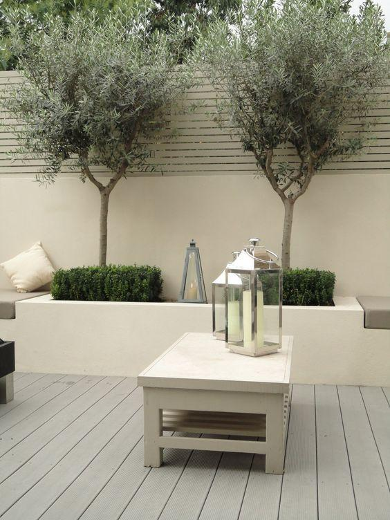 Bright minimalist patio design with table and candle lanterns