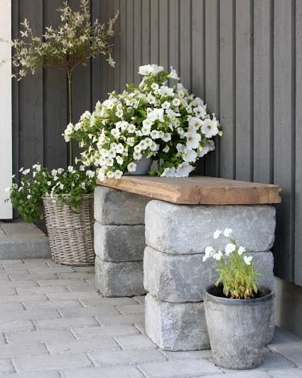 simple stacked stone bench with flowers