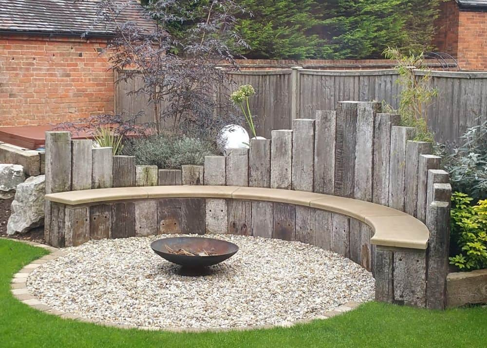 curved seating area with gravel circle and fire pit